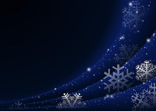雪片の青色の背景