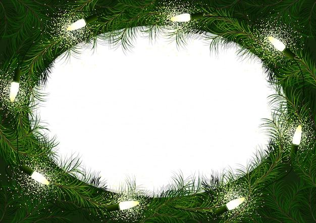 輝くクリスマスライトとクリスマスリース