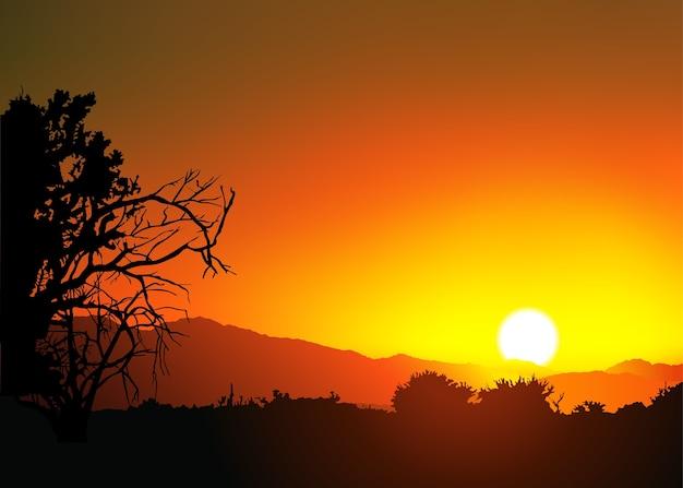 オレンジ色の夕日に木が茂っています