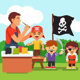 子供たちが幼稚園で顔を塗るパーティーを海賊
