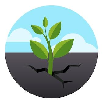 小さな緑の芽がアスファルト地面を通って育つ