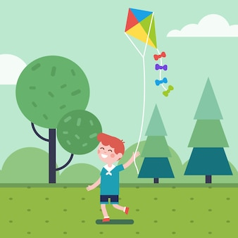 公園の凧で遊んでいる少年