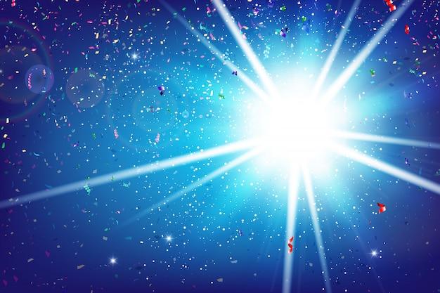虹リボンのフラクタルが爆発し、照明と青色の背景に落ちる