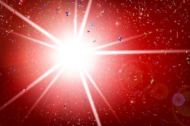 レインボーリボンのフラクタルが爆発し、照明と赤の背景に落ちる