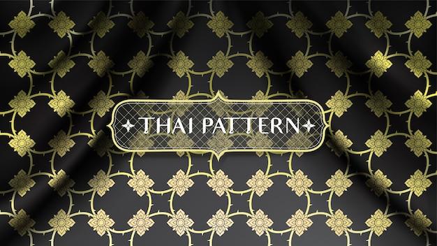 Абстрактный золотой традиционный тайский узор, соединяющий цветы, на фоне волнистой гладкой кривой черной шелковой ткани