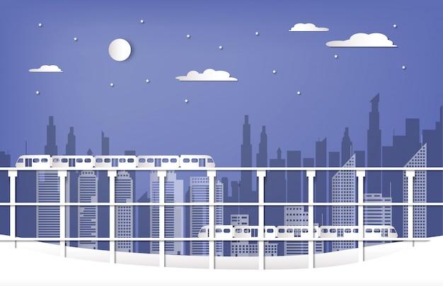 紙のスタイルで冬のシーズンの空鉄道レールと都市背景