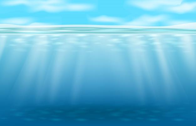 深い青色の水中と光線の抽象的な背景