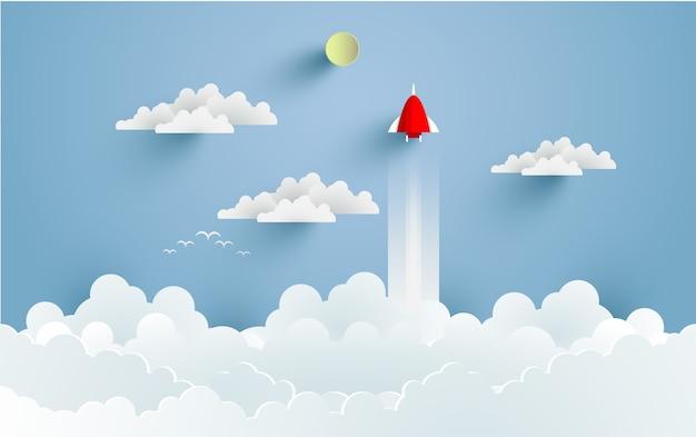 Ракеты летят в космос с потрясающими облаками. дизайн бумажного искусства и ремесел