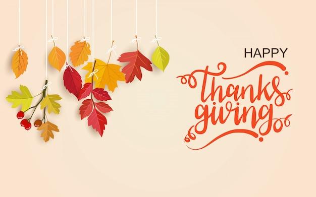 レタリングとぶら下がっている葉と幸せな感謝祭の日グリーティングカード