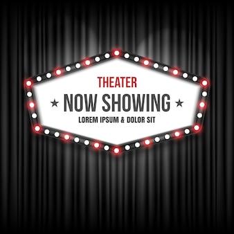 Театральный знак кинотеатра на черном занавесе