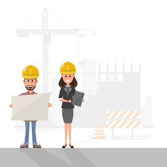 作業員が建物のサイトでプロジェクトを管理する