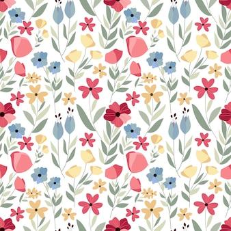 手が白い背景と花のシームレスなパターンを描画