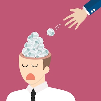 実業家の頭の中に紙をぶつけた手