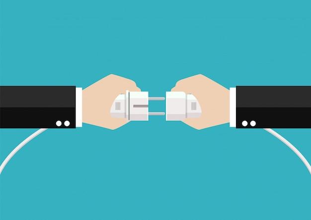 Бизнесмены руки соединяют вилку и розетку