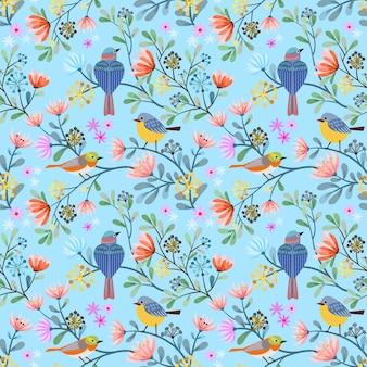 花のシームレスなパターンと枝に鳥。