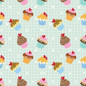 ハート形のパターンを持つかわいいカップケーキ。