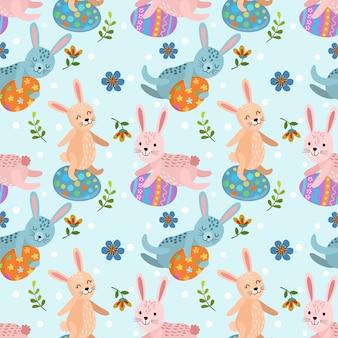 イースターエッグのシームレスパターンとウサギ