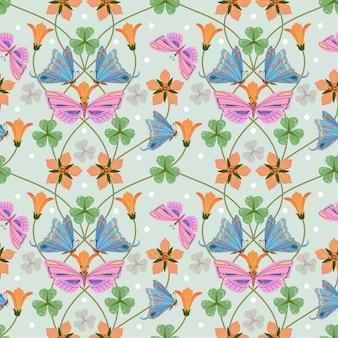 蝶と花のシームレスなパターンの生地の織物の壁紙。