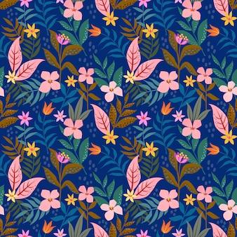 青い背景のシームレスパターンの小さなピンクの花花。