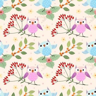 枝のシームレスパターンのかわいいフクロウは、織物の繊維に使用できます。
