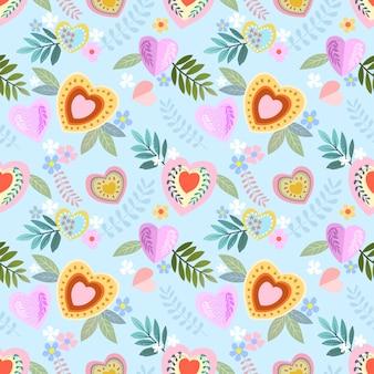 花のシームレスなパターンを持つカラフルなハート形。