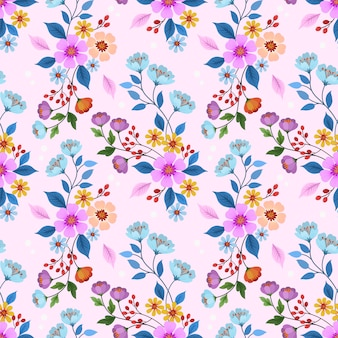ピンク色のシームレスパターンで描かれた花を手します。