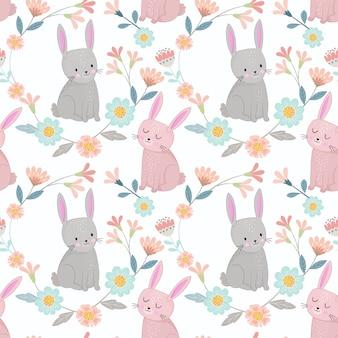 花の庭のシームレスパターンの生地の織物の壁紙でかわいいウサギ。