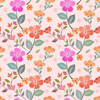 色とりどりの花のシームレスなパターンベクトルデザイン。ファブリックテキスタイルの壁紙に使用できます。