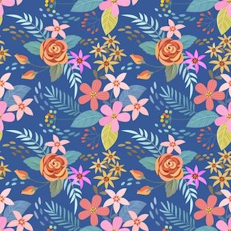 青色の背景のシームレスなパターンにカラフルな手描きの花。