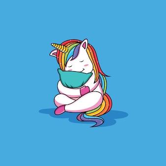 かわいいユニコーンは枕を抱いています。