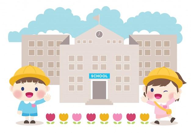 学校の子供たちと小学校の建物