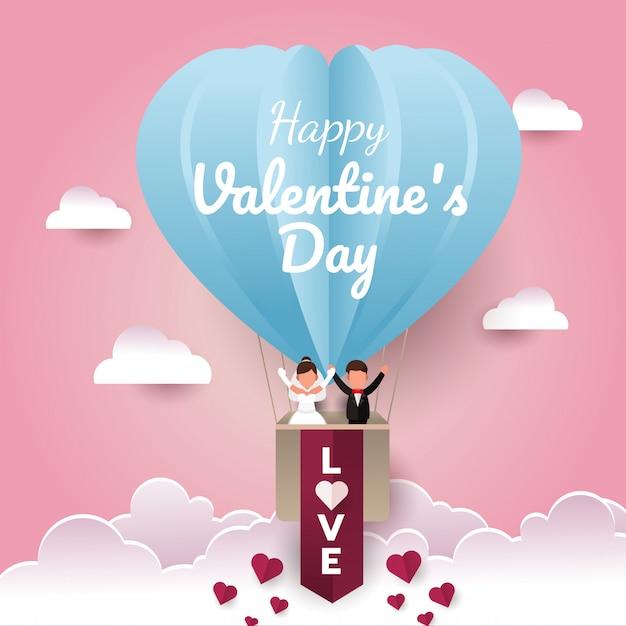 バレンタインデーの紙カットカード。空に気球で幸せな結婚式のカップル