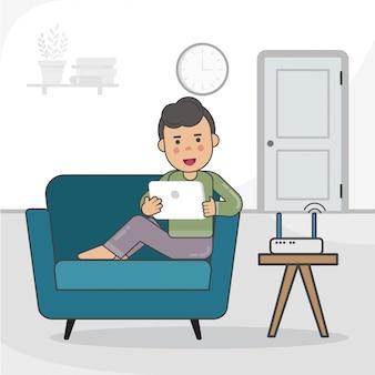 タブレットで自宅で勉強する少年