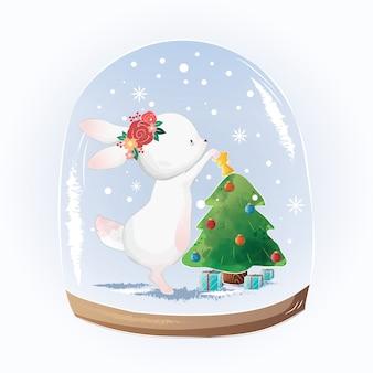 かわいいバニーはクリスマスツリーを飾る