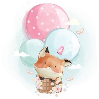 かわいいキツネが風船で飛んで