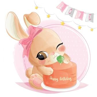 彼女の誕生日ケーキとかわいいウサギ