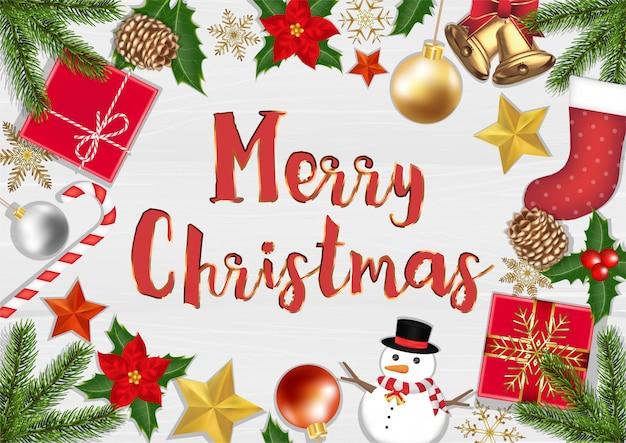 木製の背景のポスターにメリークリスマストオブジェクトトップビュー