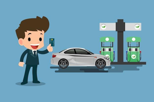 ハッピービジネスマンは彼のクレジットカードを使用して、彼の車に燃料を補給します