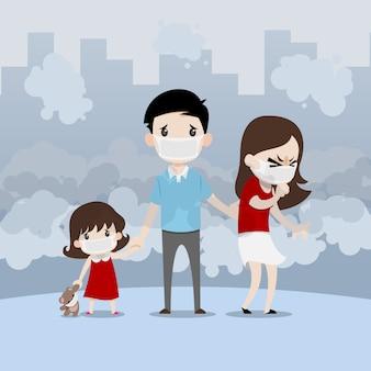 汚染都市でマスクを身に着けている家族。