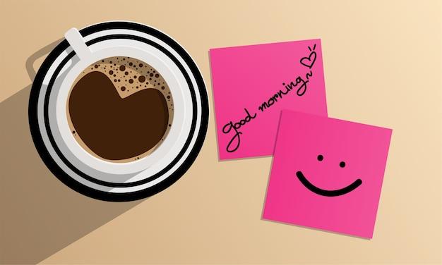 Черный кофе в верхней части чашки и доброе утро текст и улыбка лица на розовой бумаге.