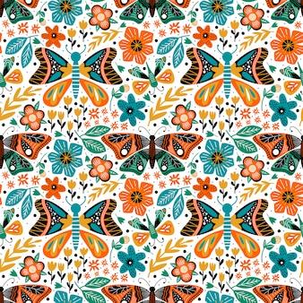 咲く花と自然の葉のシームレスなパターンと蝶