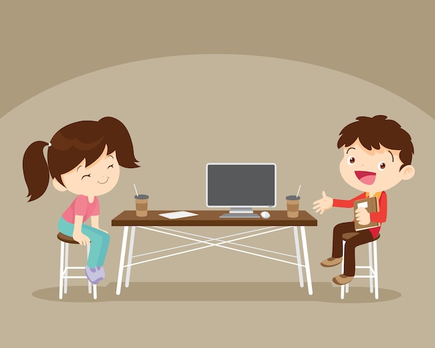 Мальчик и девочка сидел рабочий стол