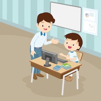 学生の少年にコンピューターを教える教師