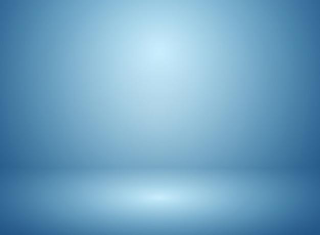 グラデーションの青いスタジオと壁の背景の抽象的なソフトぼかし。