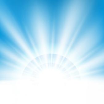 テキストスペースでクリーンな青い空の背景に中央の太陽光の光の効果