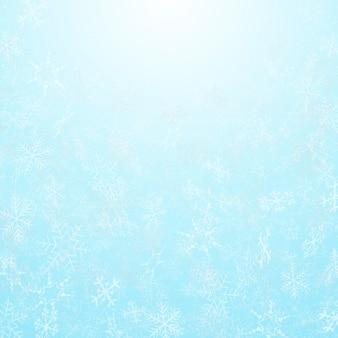 空の背景を持つクリスマスフェスティバルの雪片の概要。