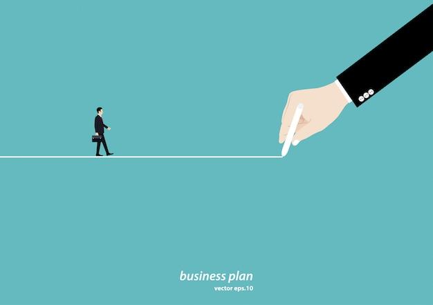 Рука рисует линию, ведущую к цели успеха в бизнесе