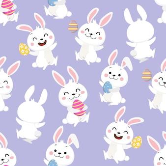 幸せの白いウサギとイースターエッグのシームレスパターン