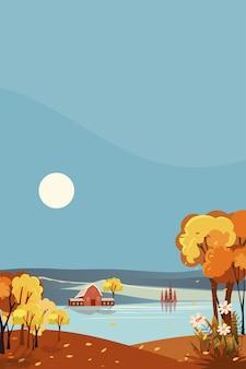 秋の田舎の垂直ファンタジーパノラマ風景。太陽と青い空と湖のほとりの農場の家と中秋のパノラマ。オレンジの葉の秋の風景。