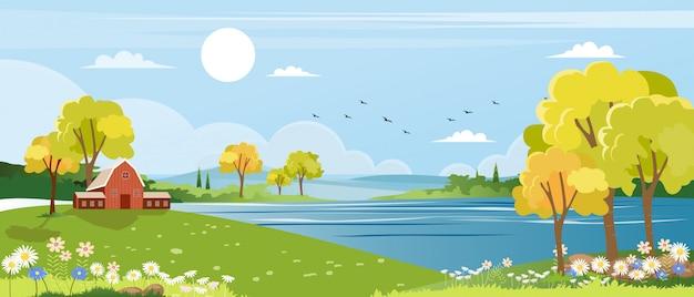 Панорама пейзажей весенней деревни с зелёным лугом на холмах с голубым небом